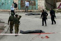 جندي صهيوني يعدم جريحا فلسطينيا 122_14-thumb2.jpg