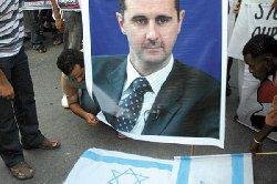 سنواصل القتال أثناء المفاوضات Assad burnn_0-thumb2.jpg