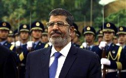 نهائي بحبس مرسي عامًا والإخوان morsi_4-thumb2.jpg